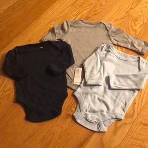 Brand new bundle of 3 long sleeve onesies!